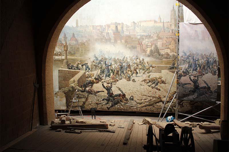 Диорама, которая демонстрирует бой на Карловом мосту со шведами.